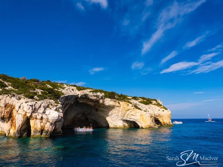 cliffs caves sky greece